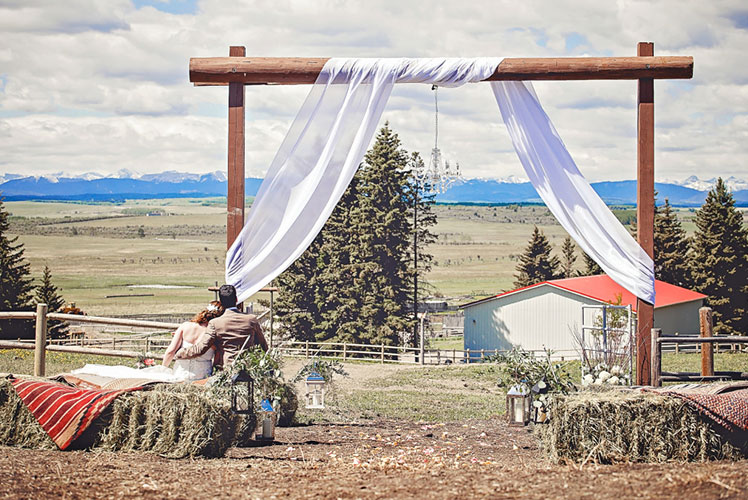bride-and-groom-admiring-the-scenery-Calgary-wedding-planner-1024x683