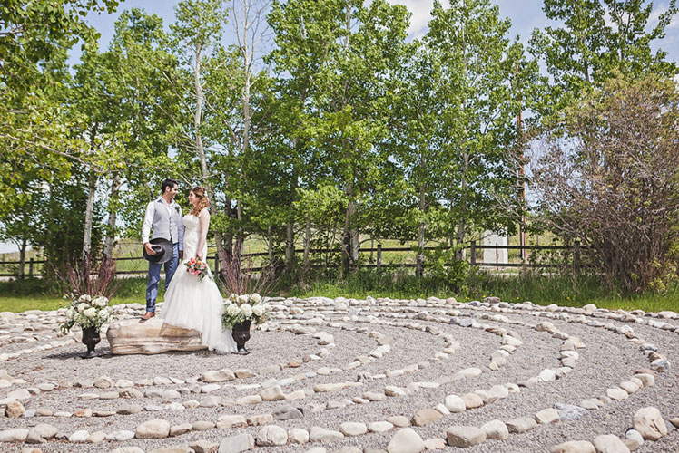 bride-and-groom-on-a-rock-calgary-wedding-planner-1024x683