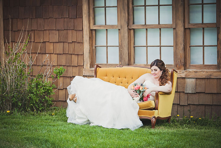 bride-sitting-on-a-vintage-couch-calgary-wedding-planner-1024x682