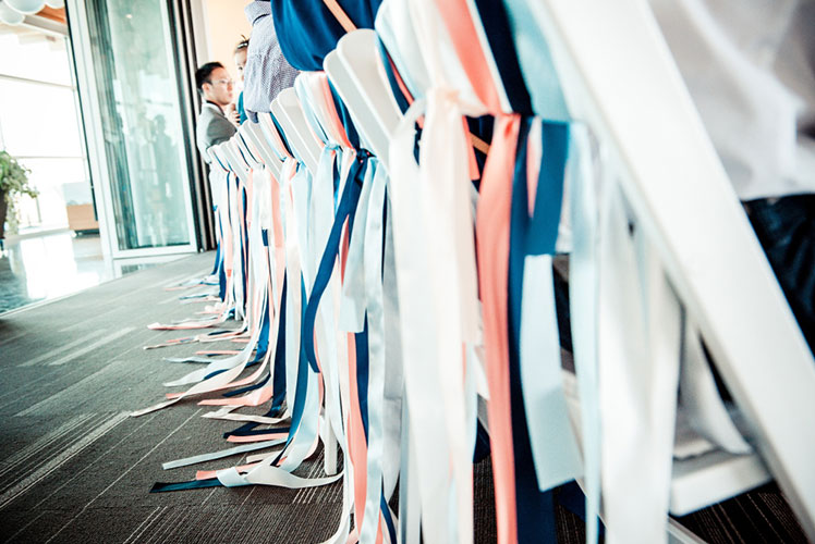 ribbons-on-wedding-guests-chairs-Calgary-wedding-planner1-1024x681