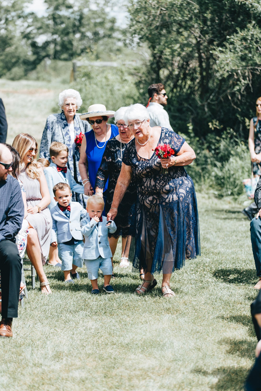 acreage-wedding, tent wedding, amazing caterer, beautiful flowers, horses Invite your grandmas to be your flower girls