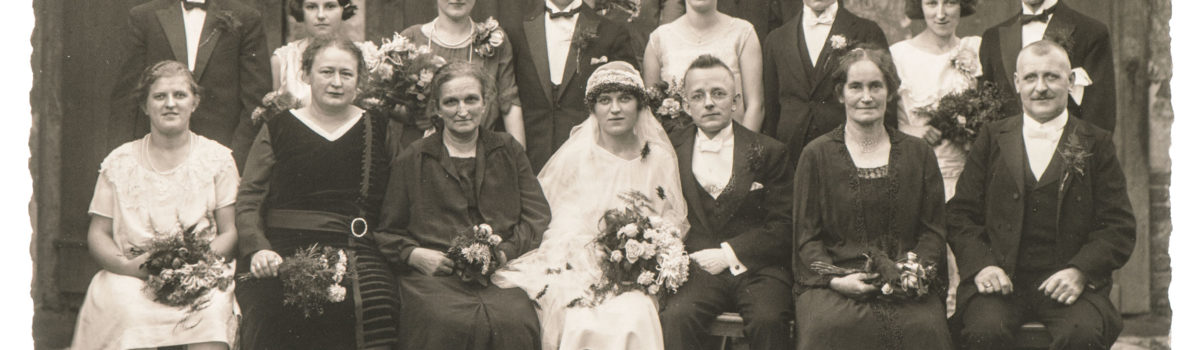 55317090 - berlin, germany - circa 1936: old family wedding photo. people wearing vintage clothing. antique fashion dress