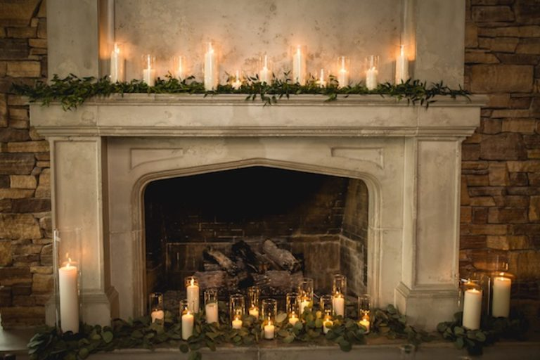 Rustic chic wedding fireplace candles